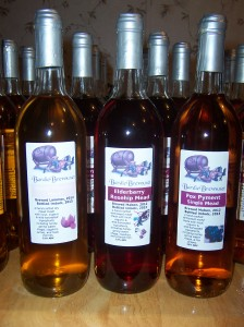 Husk Cherry Mead (on left, the label is not very readable due to a printer malfunction), Elderberry Rosehip Mead, and Fox Pyment Single Mead